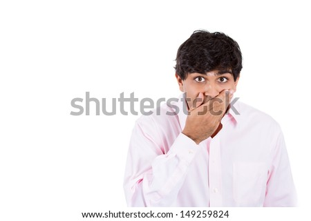 Closeup portrait of surprised handsome young guy, with copy space to left, isolated on white background