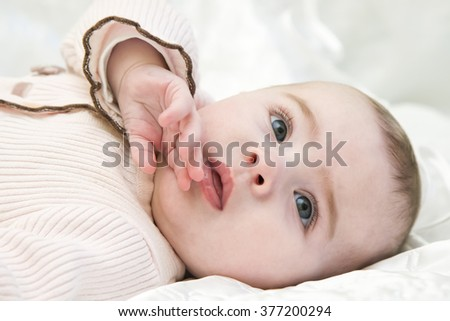 closeup portrait of sweet baby girl background - stock photo