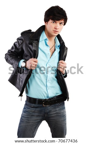 Closeup portrait of the beautiful young sexual man in a leather jacket, on a white background - stock photo