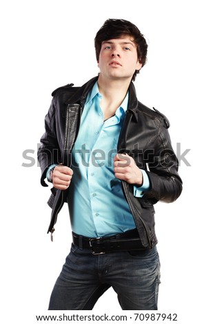 Closeup portrait of the beautiful young sexual man in a leather jacket, on a white background