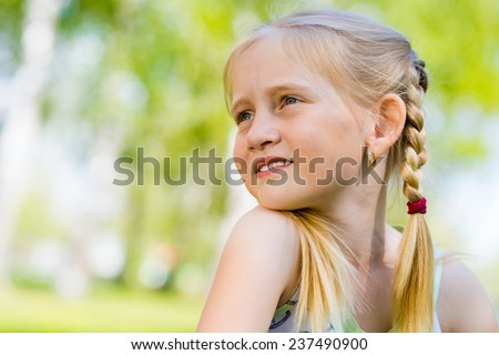 closeup portrait of the girl in a summer park - stock photo
