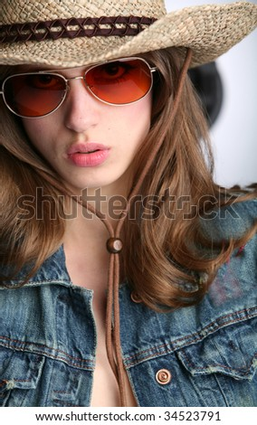 closeup portrait of the girl in stetson - stock photo