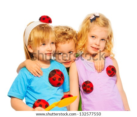 Closeup portrait of  three blond kids boy and girls hugging isolated on white