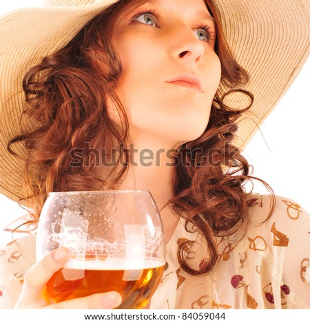 Closeup portrait of trendy gorgeous woman wearing stylish dress and summer hat holding glass of beer
