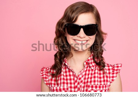 Closeup portrait of trendy young girl in black goggles