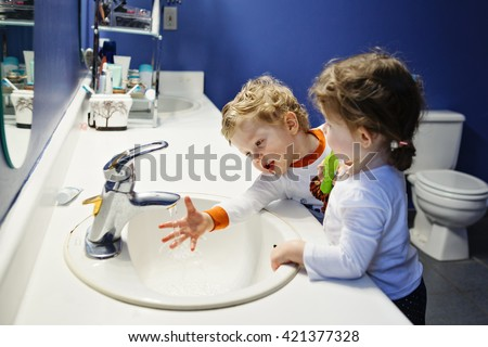 Image result for a little boy and a girl brushing their teeth