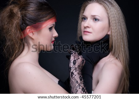 Closeup portrait of two girls: black & white or good & evil
