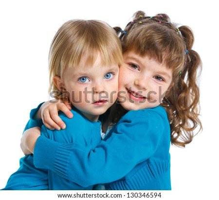 Closeup portrait of two happy cute sisters. Isolated white background - stock photo