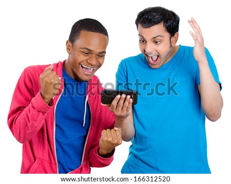 Closeup portrait of two men looking shocked with opened mouth on a cell phone watching a football game or reading an sms, e-mail viewing latest news, isolated on a white background. Positive emotion  - stock photo