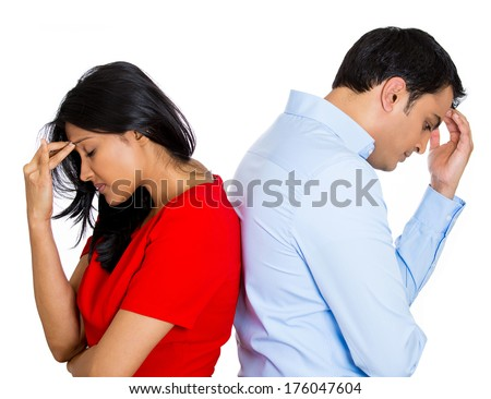 Closeup portrait of two people, couple woman and young man, back to back, very sad, disappointed with each other, isolated white background. Marriage, relationship problems. Negative facial reaction