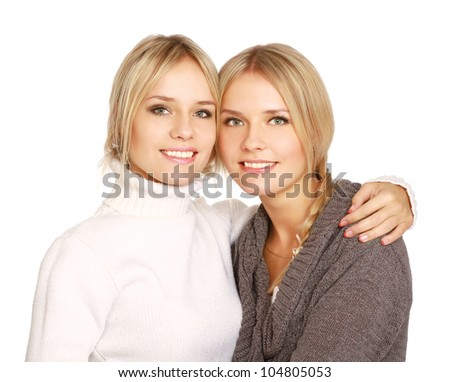 Closeup portrait of two women smiling isolated on white background