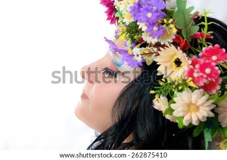 Closeup portrait of Ukrainian girl with colorful corolla on the head. portrait in profile - stock photo