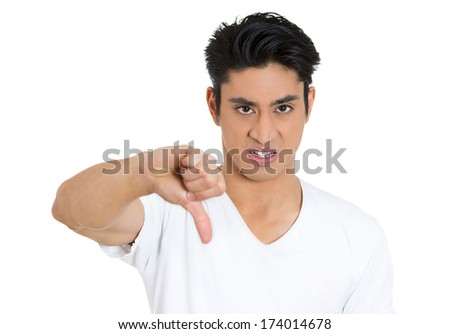 Closeup portrait of unhappy angry, mad, pissed off man, annoyed guy, giving thumbs down gesture looking with negative facial expression, disapproval, isolated on white background. Human emotions signs