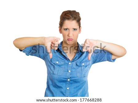 Closeup portrait of unhappy, angry, mad, pissed off woman, annoyed wife, giving thumb down gesture looking with negative facial expression, disapproval, isolated on white background. Human emotions - stock photo
