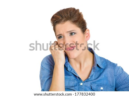 Closeup portrait of unhappy, annoyed young woman, thinking student, isolated on white background. Negative human emotions, facial expressions, attitude, perception, interpersonal conflict resolution.