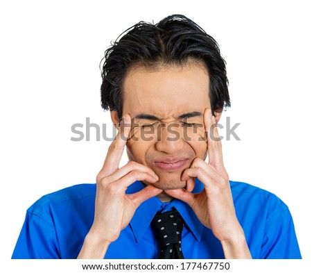 Closeup portrait of unhappy, sad, thoughtful, young business man thinking deeply, bothered by mistakes, hands on head, having headache isolated on white background. Negative emotion facial expressions - stock photo