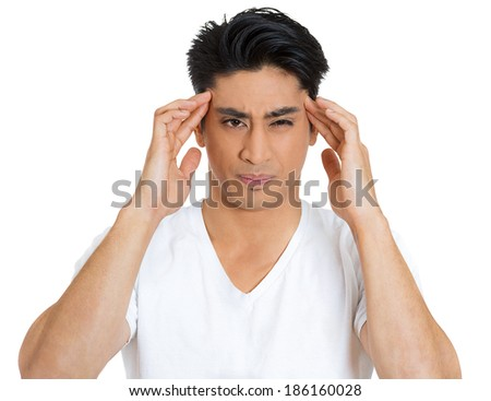 Closeup portrait of unhappy, sad, thoughtful, young business man thinking deeply, bothered by mistakes, hands on head, having headache isolated on white background. Negative emotion facial expressions
