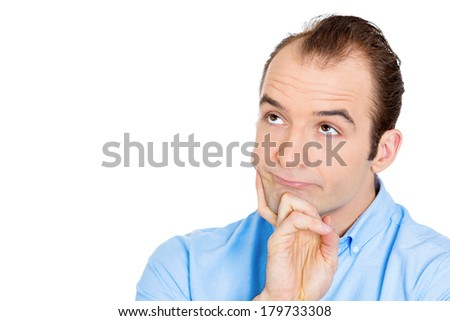 Closeup portrait of unhappy, sorry guy, sad, thoughtful young business man thinking, daydreaming deeply, bothered by mistakes, hand on chin looking up, isolated on white background. Negative emotions
