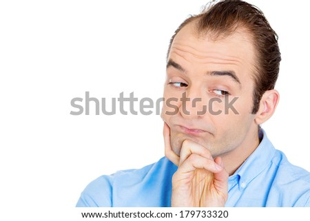 Closeup portrait of unhappy, sorry guy, sad, thoughtful young business man thinking, daydreaming deeply, bothered by mistakes, hand on chin looking away, isolated white background. Negative emotions - stock photo