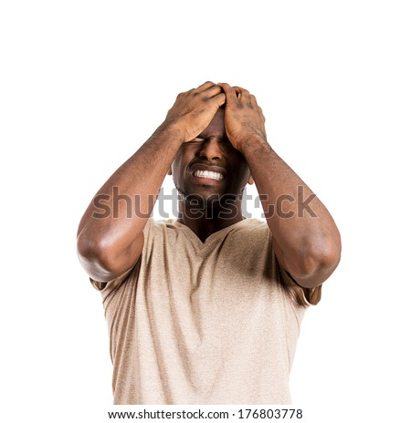 Closeup portrait of unhappy upset guy, sad thoughtful young business man thinking deeply, bothered by mistakes, hands on head, eyes closed, headache isolated on white background. Negative emotions - stock photo