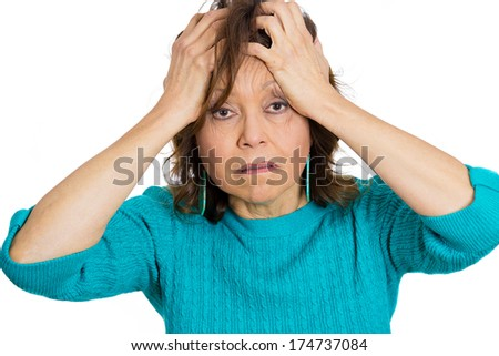 Closeup portrait of unhappy upset senior mature woman having really bad day at work or home, hands on head stressed confused, isolated on white background. Negative emotion facial expression feelings. - stock photo