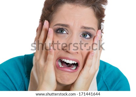 Closeup portrait of unhappy upset woman with hands on cheeks about to have nervous breakdown, isolated on white background. Negative emotion facial expression feelings, body language - stock photo