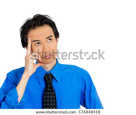 Closeup portrait of unhappy young man thinking daydreaming deeply bothered by something hand on face looking upwards, isolated on white background. Negative emotion facial expression feeling - stock photo