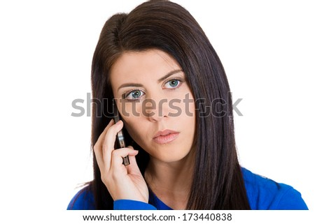 Closeup portrait of upset, sad, depressed, unhappy worried brunette woman talking on the phone, isolated on white background. Negative human emotions, facial expressions, feelings, reaction. Bad news. - stock photo