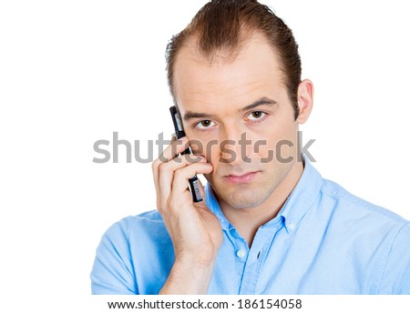 Closeup portrait of upset, sad, depressed, unhappy worried young man talking on cell phone, isolated white background. Negative human emotions, facial expressions, feelings, reaction. Bad news.