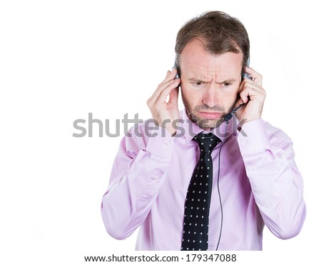 Closeup portrait of upset, sad, depressed, worried business man, customer service representative receiving bad news on hands free device, talking on phone, isolated white background. Face expressions - stock photo