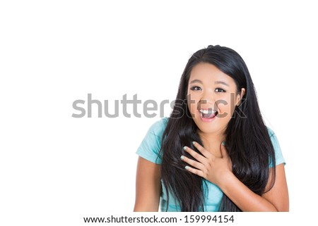 Closeup portrait of very excited and surprised young woman holding hand on chest in amazement. Isolated on white background with copy space - stock photo
