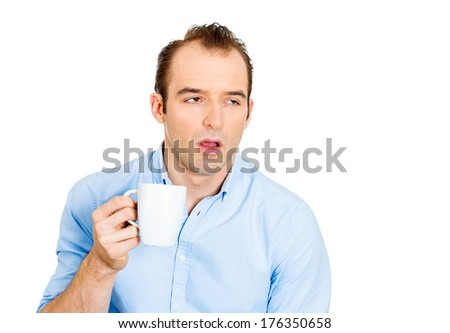 Closeup portrait of very tired falling asleep young business man, no energy motivation, struggling not to crash stay awake keeping his eyes opened, isolated white background. Human emotion, expression - stock photo