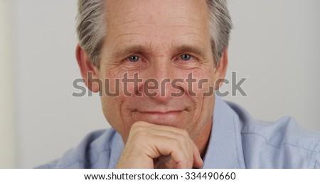 Closeup portrait of white senior man smiling - stock photo