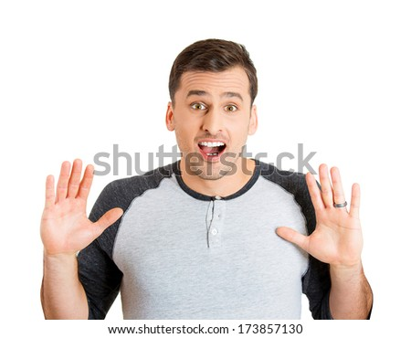 Closeup portrait of wild, goofy, crazy, funny, shocked surprised stunned young man face with hands in air, wide open mouth, isolated on white background. Positive human emotion facial expression