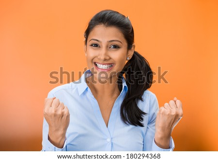 Closeup portrait of winning successful young business woman, happy ecstatic celebrating being winner, isolated on orange background. Positive human emotion facial expressions. Life achievement concept