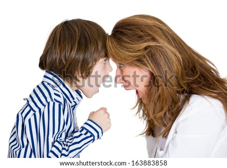 Closeup portrait of woman and boy fist up yelling screaming shouting at each other heads together out of control , isolated on white background. Negative human emotion facial expression conflict - stock photo