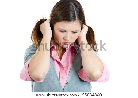 Closeup portrait of woman holding hair behind head very upset and sad, isolated on white background - stock photo