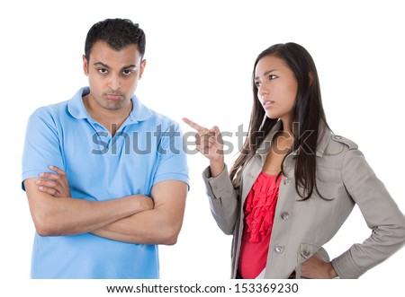 Closeup portrait of woman pointing at man as if to say bad boy because he did something wrong, isolated on white background - stock photo