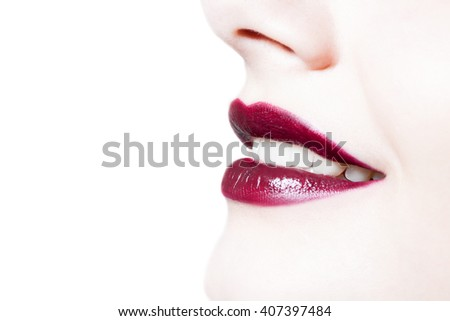 closeup portrait of  woman's  dark red  color lips