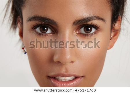 closeup portrait of woman's face with wondering emotion on it