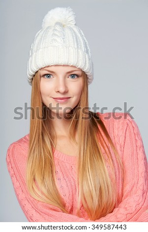 Closeup portrait of woman wearing woolen hat and sweater with amazement on her face