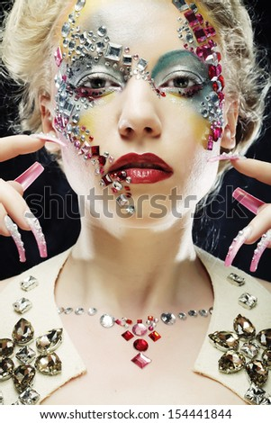 Closeup portrait of woman with artistic make-up. Luxury image. - stock photo
