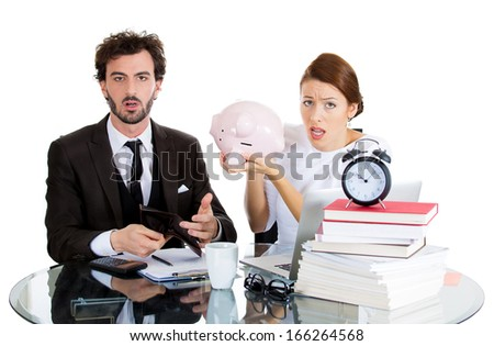Closeup portrait of worried, anxious, young couple, man, woman showing empty piggy bank, looking distressed from financial problems, mounting bills, isolated on white background. Bad finance decisions