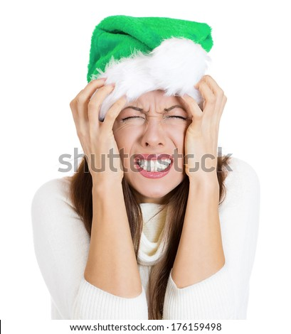 Closeup portrait of worried stressed overwhelmed young woman, funny looking girl wearing green hat, screaming going crazy, isolated on white background. Human emotions, facial expressions, reaction  - stock photo