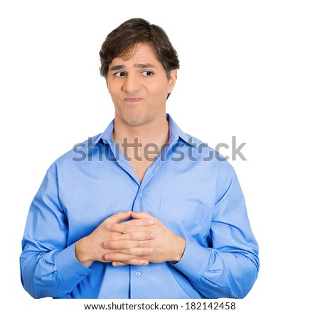 Closeup portrait of young adult man who is bothered by mistakes he has made, playing hands nervously, isolated on white background. Negative human emotion facial expression feelings, body language. - stock photo