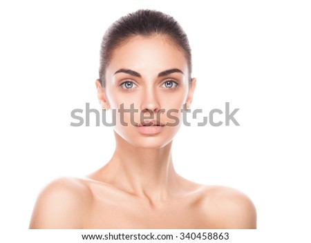 closeup portrait of young adult woman with clean fresh skin isolated on white