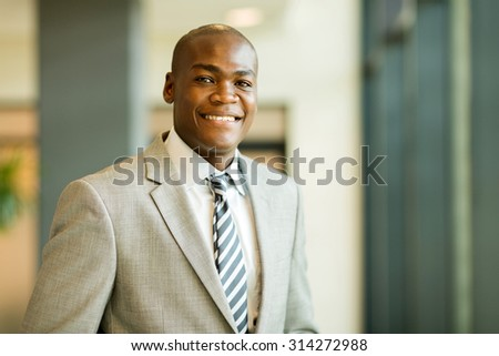 closeup portrait of young african american businessman in office