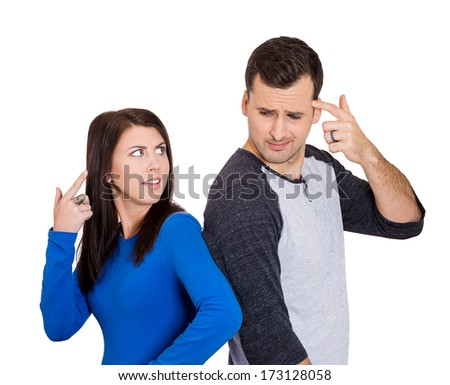 Closeup portrait of young angry couple, man, woman, gesturing are you crazy, blaming for problem, isolated on white background. Marriage difficulties concept, negative emotions, expressions, feelings - stock photo
