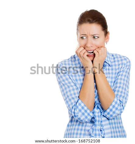 Closeup portrait of young, anxious, worried, unhappy woman biting her nails and looking sideways, craving for something, afraid isolated on white background. Human face expressions, emotions, feelings - stock photo