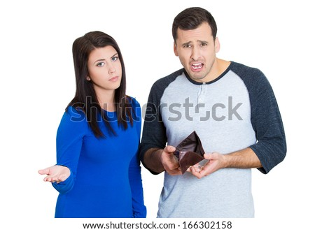 Closeup portrait of young attractive man woman couple showing empty wallet, being broke over the budget and poor, isolated on white background. Negative facial expression emotion feelings - stock photo